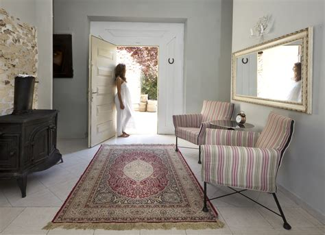 A Refined Rich Classic Persian Design Medallion Rug Adds A Touch Of Opulence To This Otherwise Carpet Tile Installation Best Cleaning Denver Deep Cleaner For Homes Black White Red Squares Wholesale Seattle Stain Repair