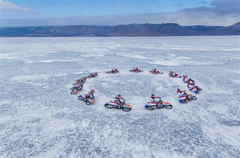 Russian Moto Racer Rides on Ice of Lake Baikal (PHOTO, VIDEO