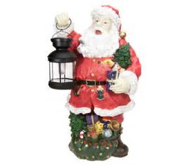 24 quot outdoor poly resin santa w solar powered lantern qvc com