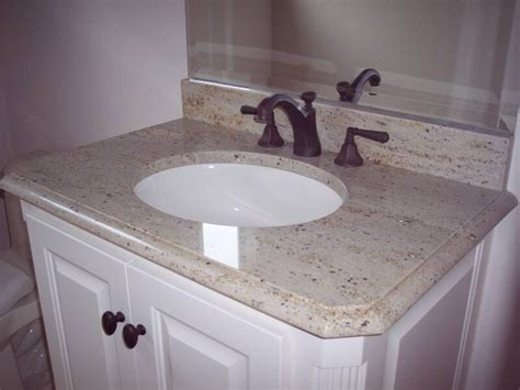 crema pearl granite but dont like with bronze fixture
