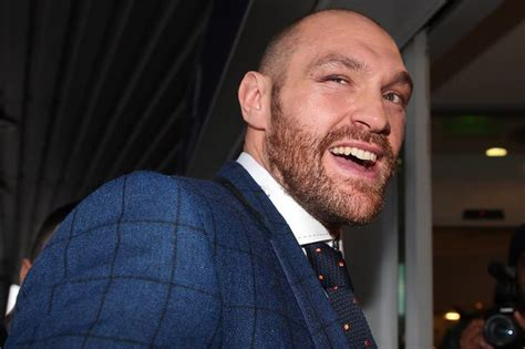 Tyson Fury poses with belts and tells critics: