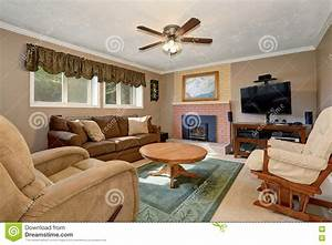 Typical American Living Room With Brown Couch And ...