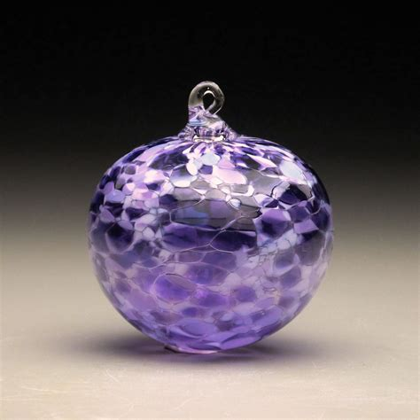 hand made blown glass christmas ornament in tones of purple