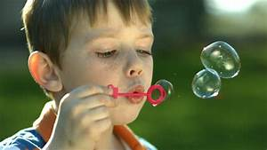 Boy Blowing Bubbles, Slow Motion Stock Footage Video (100% ...  Blowing