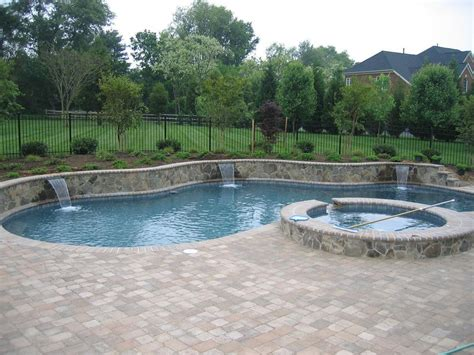 raised pool swimming pool and spa with raised beam and techo bloc pavers in howard county maryland yelp