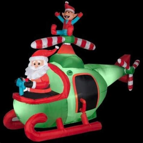 huge  christmas santa clause twirling helicopter rotor