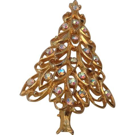 filigree christmas tree pin with iridescent rhinestones