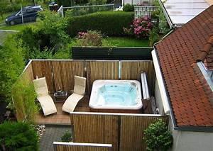 Sichtschutzelemente aus bambus und edelstahl bambusrohre for Whirlpool garten mit frostschutz pflanzen balkon