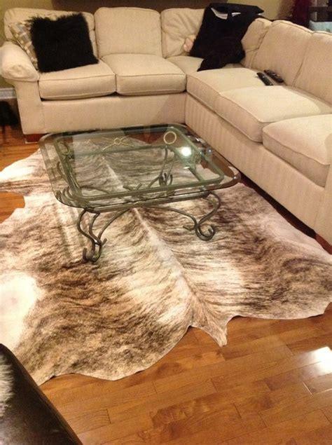 cowhide rug   cozy    hoped