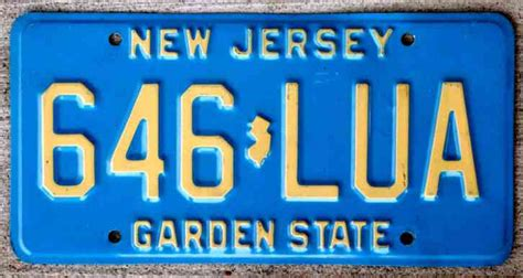 Light Cream Color On Blue New Jersey License Plate