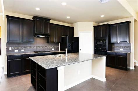 kitchen cabinets  black appliances vlggzg white