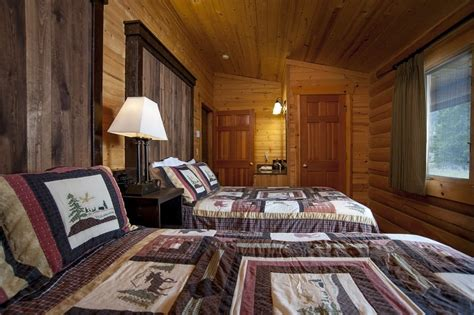montana log cabins yellowstone riverfront accommodations  guest ranch