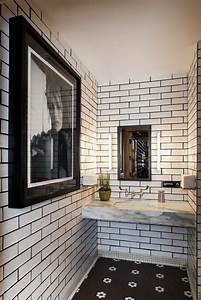 white subway tiles with black grout and black tile floor With white bathroom tiles with black grout