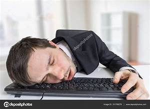 Exhausted or tired businessman is sleeping on keyboard in ...