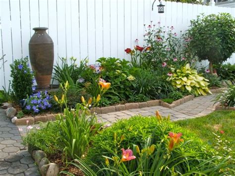 perennial garden in small backyard with large pottery as