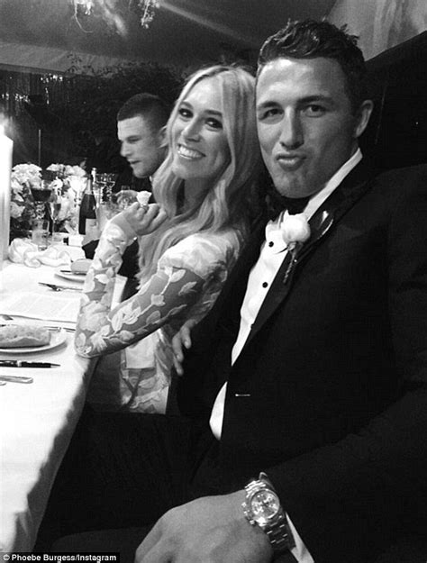 Sam Burgess places a protective hand on his pregnant wife