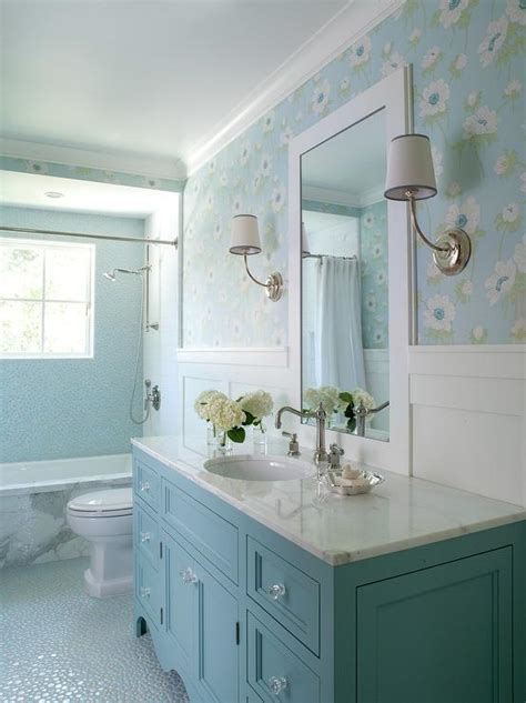 blue bathroom with blue washstand and board and batten