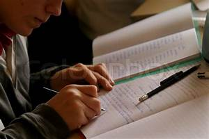 Cropped view of young man writing in book | Stock Photo ...