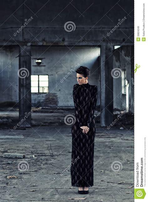 fashion model posing  abandoned building stock photo