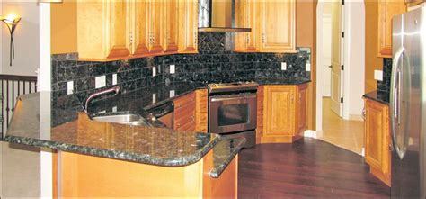 exquisitely finished home features marble granite and