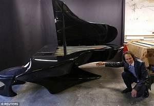 Gergely Boganyi designs futuristic Bat-piano made of ...