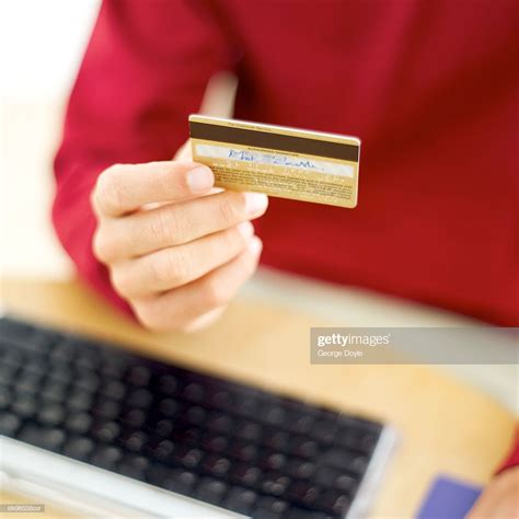 Check spelling or type a new query. Person Holding A Credit Card High-Res Stock Photo - Getty Images