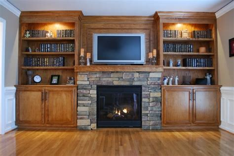 custom built in cabinets and surround fireplace