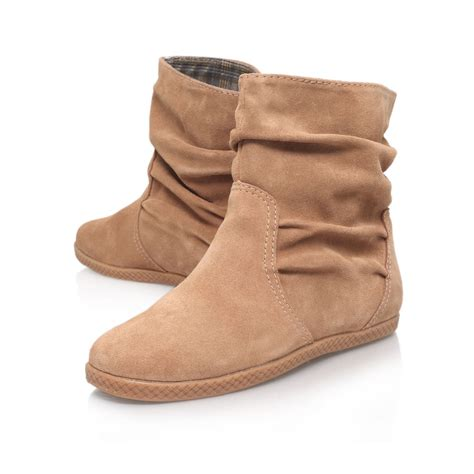Flat Bootie by Nine West Rockinout Flat Ankle Boots In Natural Lyst