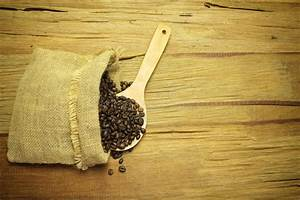Spilled Coffee Beans In Bag On Wood Stock Photo - Image of ...