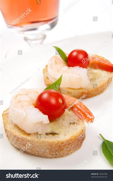 canape spread closeup delicious shrimp canape cherry tomatoes stock