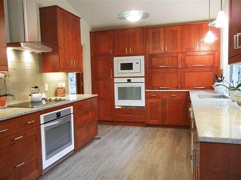 ikea custom kitchen cabinets ikea adel medium brown cabinets custom appliance garage 4426