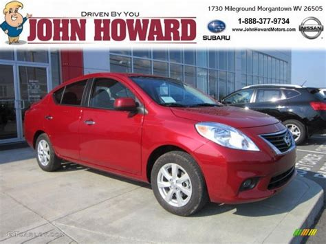 red nissan versa 2012 red brick nissan versa 1 6 sl sedan 53982409 photo
