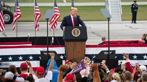 rally trump york michigan times masks without after showing reporter removed donald mask president washington usa campaign thursday today biden