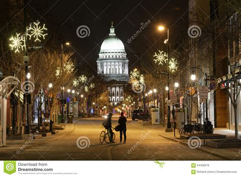 christmas lights in madison ms couple in street looking at capitol on a snowy evening in