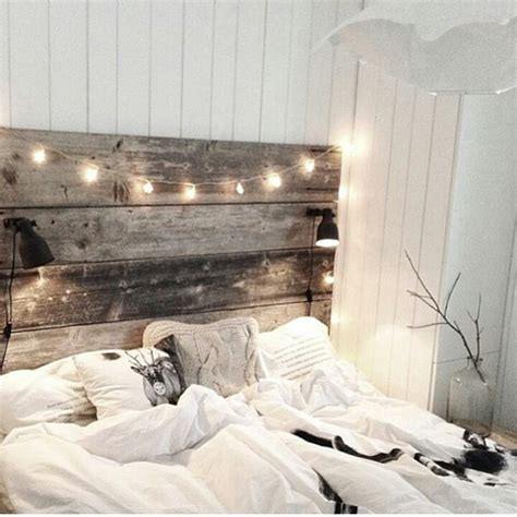 wooden headboard with reading ls twinkle lights bedroom