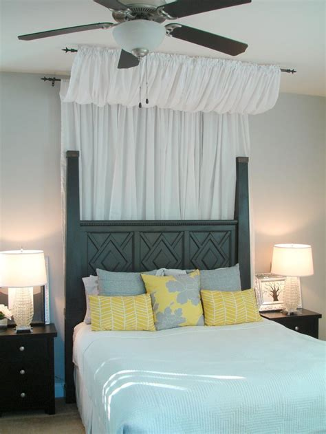 how to make a bed canopy love the curtain above behind the bed dwellings by devore easy diy canopy for under 50