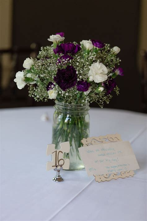 puzzle piece table number  purple  white carnations
