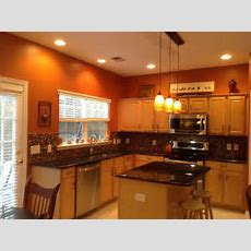 Burnt Orange Kitchen With New Lighting!  Ideas For The