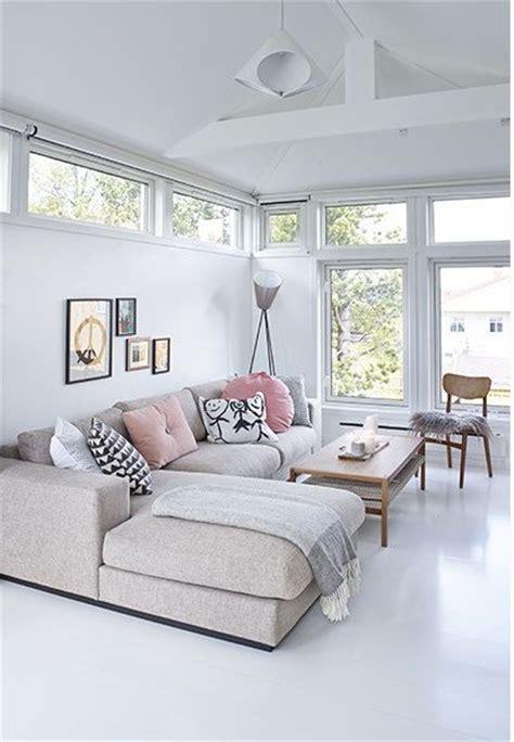 neutral living room white walls floor beige minimalist wall lots of light