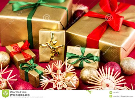 six golden xmas presents with bows stock photo image