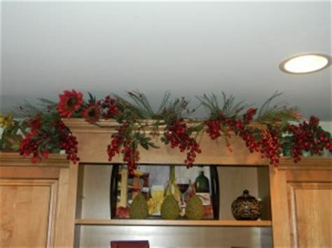 garland above kitchen cabinets decorating above kitchen cabinets before and after 3735