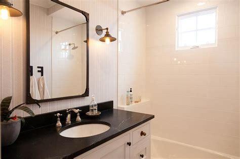 white pedestal sink  aged brass rivet mirror