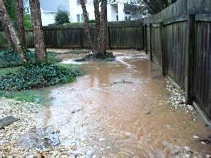 sloping yard solutions common drainage problems