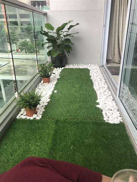 tiny balcony  artificial grass  river pebbles
