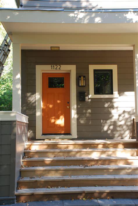 orange door grey house it with the white trim