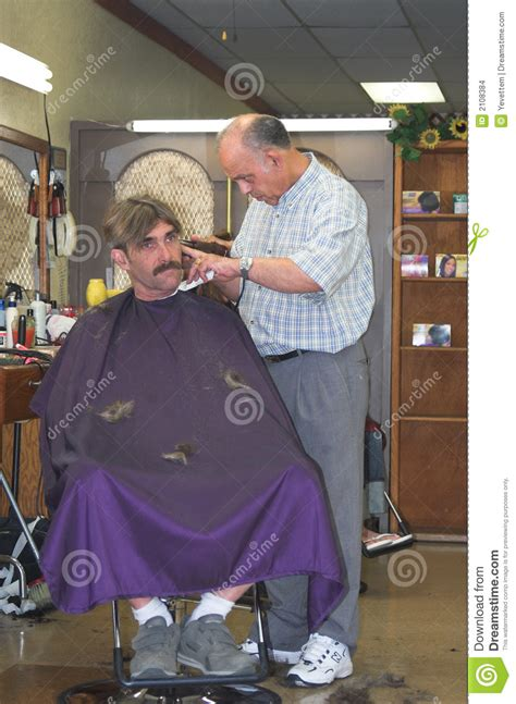 barber cutting mans hair stock images image