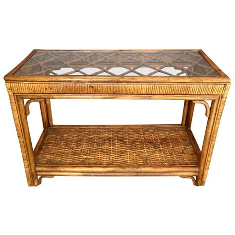 handsome rattan  glass console table  sale  stdibs