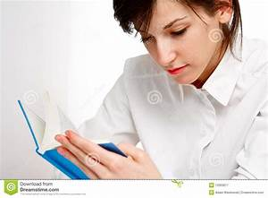 Young Woman Reading A Book With Attention Royalty Free ...