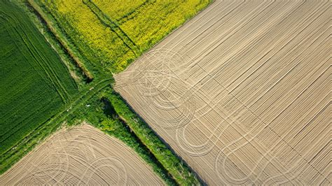 City At Night Wallpaper Aerial View On The Tractor Traces On The Field Nysa Poland Windows 10 Spotlight Images