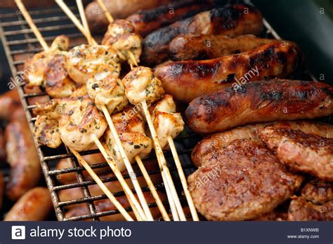 grill cuisine food on bbq grill cooking chicken and sausages stock photo royalty free image 18412951 alamy